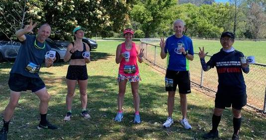 Karin (Kaz) Tappouras stands between four of the runners in the Triple Bucketts Marathon Series Challenge on day three. Photo supplied